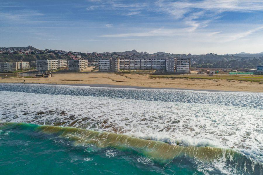 Vista aérea: Proyecto a orilla de playa